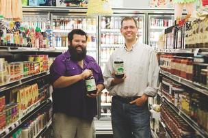 Chameleon Coffee co-founders Steve Williams, left, and Chris Campbell display their company's product at Thom's Market.
