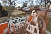 Construction on new sidewalks is ongoing. Much of Rainey and the surrounding streets don't have sidewalks, which forces pedestrians to walk in the street. City plans would make the street safer for joggers in the day and bar-hoppers at night by extending sidewalks down both sides of Rainey.