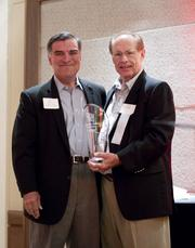 Gary Valdez (left) of Focus Strategies Investment Banking presented the 2012 Special Achievement Award to Jimmy Treybig, founder of Tandem Computers and the driving force behind local venture capital firm  NEA.