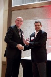 Trylko receives his award from Mike Panozzo of Holtzman Partners.