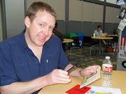 Tim Hayden of Blue Clover scans a QR code
