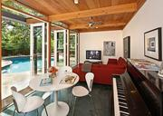 A 1940s bungalow on Bickler Road was renovated by Austin architect Rick Black. Also included in the project was a new poolside guest house.
