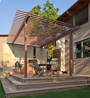 All of the materials in this house designed by architect Philip Keil were scrutinized for environmental health and sustainability. The exterior and interior spaces are connected by trellis-like detailing.