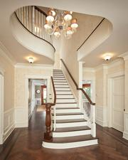 An elegant, classical stairway defines the entryway of this renovated Italianate residence designed by Austin architect Paul Clayton on Gaston Avenue.