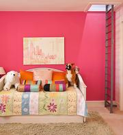 A colorful bit of whimsy defines a bedroom space in the Harris Boulevard home designed by Austin architect Mark Carlson.