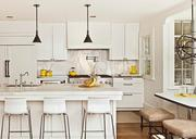 The all white kitchen features interesting materials and unique light fixtures. The architect of the 3,020-square-foot renovation on Jarratt Avenue is Tim Cuppett.