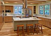 The cozy kitchen on Purple Heron Drive features wood details and stainless steel appliances. The new house was designed by Eric MacInerney.