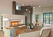 The renovation of a 1998 house on Stratford Hills Lane features an award-winning, custom fireplace. Patrick Ousey is the architect.