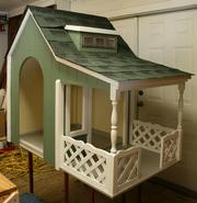 Henley Homes Inc. in collaboration with Dawn Hearn Interior Design are opting for a white picket fence inspiration for their as yet unfinished doghouse.
