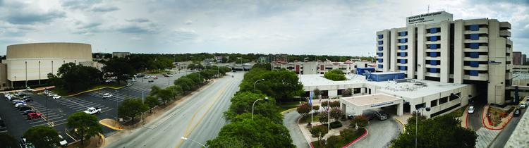 The parking lot across from University Medical Center Brackenridge could one day hold Austin's new teaching hospital, Sen. Kirk Watson said.