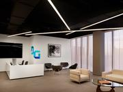 The reception area is designed with a contemporary minimalist approach. Founder Jeff Dachis' private pop art collection accents the walls, along with flat screen televisions and the corporate logo.
