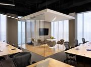 The headquarters features glass boxes as conference rooms to maintain unobstructed views of the city.