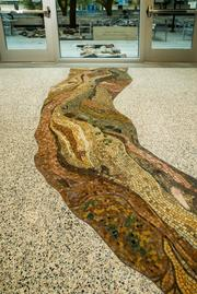 Artist Julie Richey created a mosaic in the floor at the Jackson School of Geosciences, which mimics an arroyo.Photo credit: McKinney York Architects; Thomas McConnell Photographer