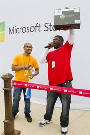 Microsoft employees announced that someone in the crowd would win an HP Envy.