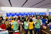 The crowd filled the store as employees danced to music played over loud speakers.