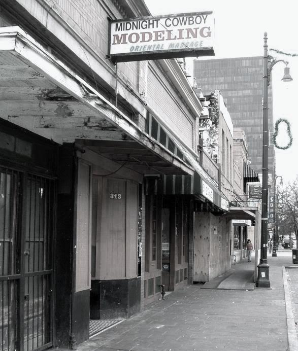 Midnight Cowboy, a high-end cocktail bar on Sixth Street, was previously home to Midnight Cowboy Modeling Oriental Massage, which ran a brothel for more than 30 years until it was busted by the FBI in early 2011.