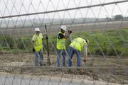Crews must trudge through Texas' summer heat, which tops 100 degrees on some days.