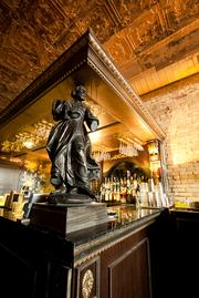 A statue placed on the bar corner looks out over the main room.