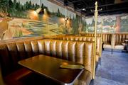 Seating booths in the main bar are covered in large snakeskin.