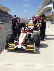 Ceremony attendees were offered rides around the track in this three-seater Formula One car.