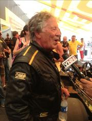 Mario Andretti talking to the press about taking the first few laps around the Circuit of The Americas racetrack.