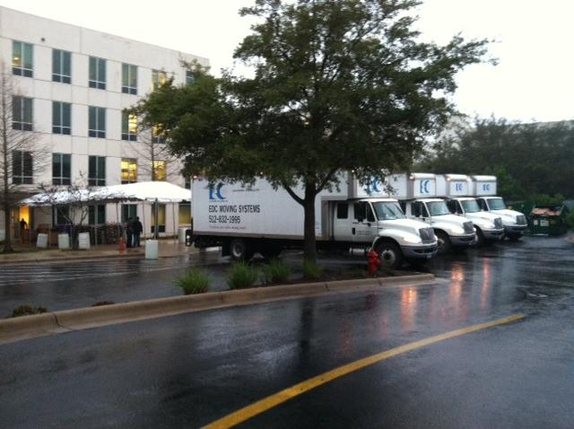 EDC Moving Systems obtained a 60-foot awning to protect equipment from the rain as it moved equipment from the truck to the building.