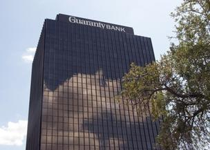 The receiver for the failed Austin-based Guaranty Bank is demanding in three separate lawsuits more than $2.1 billion from major banks that underwrote and sold securities backed by residential mortgages.