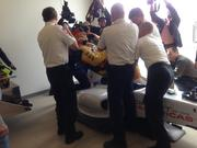 Paramedics demonstrate a race car driver extraction in the medical center at COTA.