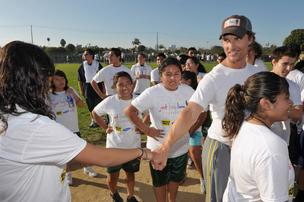 Austinite Matthew McConaughey meets children who benefit from his just keep livin foundation.