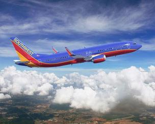 Flight attendants with Southwest Airlines have approved an agreement that would allow the carrier to fly over water to such destinations as Hawaii.