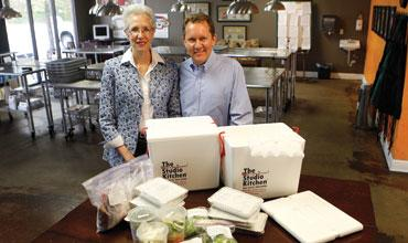 Laura and Daniel Bezden, owners of The Studio Kitchen in Round Rock, display their Five Day Meal Deal. They have seen a resurgence in demand for healthful, prepared meals.