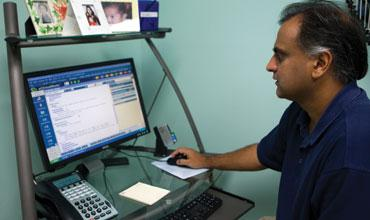 Dr. Ajay Gupta has seen work flow improve at his practice since it implemented a computer-based patient record system