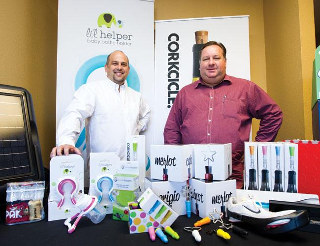 Roy Prosise, left, and Curt Stewart of BeKnown LLC show some of the many products their company has manufactured.