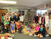 Grey Rock tennis players and staff helped the Blue Santa program brighten Christmas day for thousands of children in Central Texas.