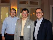 Soaking up and sharing financial know-how at a recent Bridgepoint Consulting seminar are (from left) Mark Ferguson, Michael Johnson and Bobby Zamen.