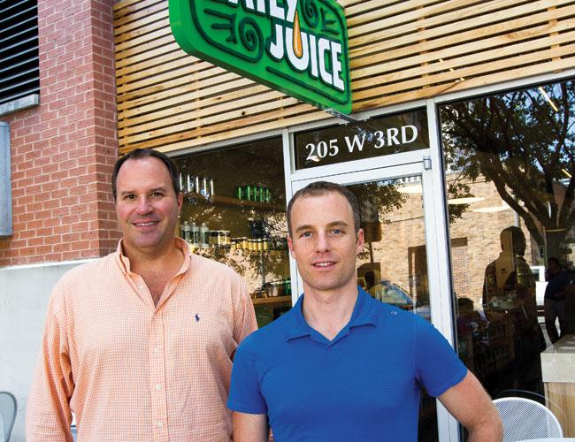 John Martin (left) and Robby Larkin at the new Daily Juice on Third Street in downtown Austin. It's their prototype store.