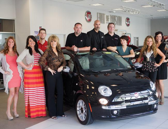 Lisa Copeland (in black slacks) leads a unique sales team that 