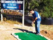 Hill Country Golf & Guitar owner Richard Phillips put a new twist on the groundbreaking ceremony with his ceremonial first putt. His entertainment venue along U.S. Highway 71 near the Hill County Galleria is scheduled to open next summer.