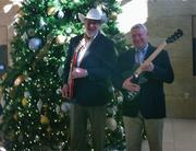 Musician Ray Benson (left) and Austin Mayor Lee Leffingwell show off two of 100 electric guitars donated to Austin Independent School District.