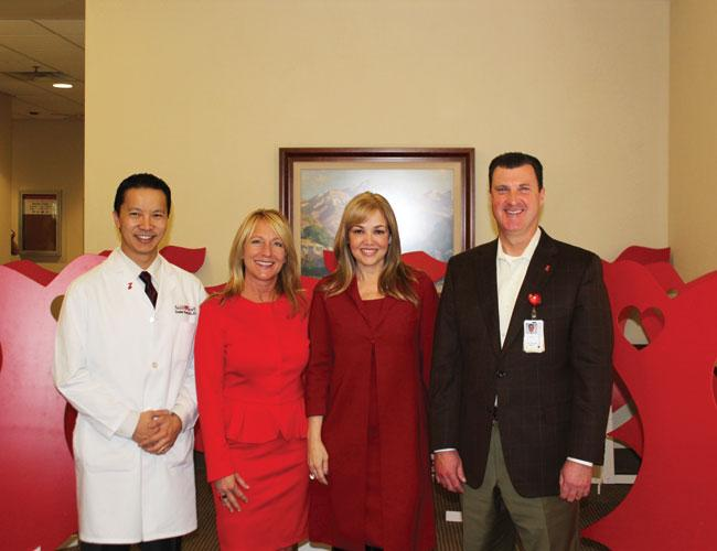 Marking the 10th anniversary of the Go Red for Women movement (from left) are Dr. Stanley Wang of Heart Hospital of Austin, Go Red for Women Chairwoman Julie White, Circle of Red Chairwoman Aida Dieck and Heart Hospital CEO David Laird.