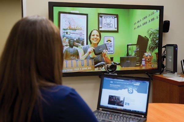 Jennifer Herzog, on screen, at LifeSize Communications explains the LifeSize Passport, which works with Skype.