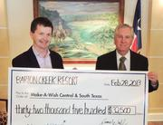 Barton Creek Resort and Spa General Manager James Walsh (left) presented Make-A-Wish Central & South Texas CEO Glenn West with a check after recent fundraising efforts.