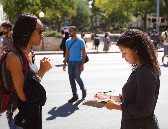 Jen Burkey, right, from marketing agency Sanders\Wingo, surveys Amara Nze, a pharmacy student at the University of Texas.