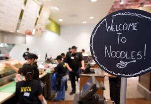 Employees go through their first day of training at the new Noodles & Co. restaurant, scheduled to open Nov. 15, at 24th and Guadalupe streeets.