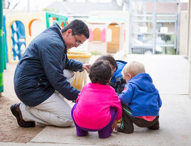 Alma Lyra, director at El Buen Pastor Early Childhood Development Center, works with toddlers. The center benefits from the mission of Raising Austin, a nonprofit that was able to increase its capacity thanks to a loan from PeopleFund.
