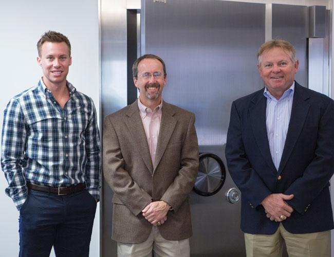 R Bank leaders, from left, Curtis Thigpen, business development officer; Mike Shaw, chief credit officer; and CEO Steve Stapp at R Bank's new location on Bee Caves Road southwest of downtown.