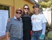 RECA President Scott Flack, RECA Executive Director Janice Cartwright (middle) and The Trail Foundation Executive Director Susan Rankin at the work site of RECA's annual Christmas in October event, where volunteers spent the day improving Austin's curb appeal.