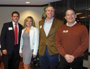 The law firm used its annual holiday party for clients and colleagues as a chance to raise funds for Meals on Wheels. From left: Joe Sanders, Natalie Scott, Chris Sileo and Thad Rosenfeld.