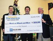 From left: Meals on Wheels and More leaders Michael C. Brown and Dan Pruett with St. David's Foundation CEO Earl Maxwell. The gift will help Meals on Wheels provide more services to seniors.