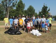Samsung Austin Semiconductor employees, families and friends picked up litter and beautified Krieg Field as a part of Keep Austin Beautiful's Lady Bird Lake Cleanup.